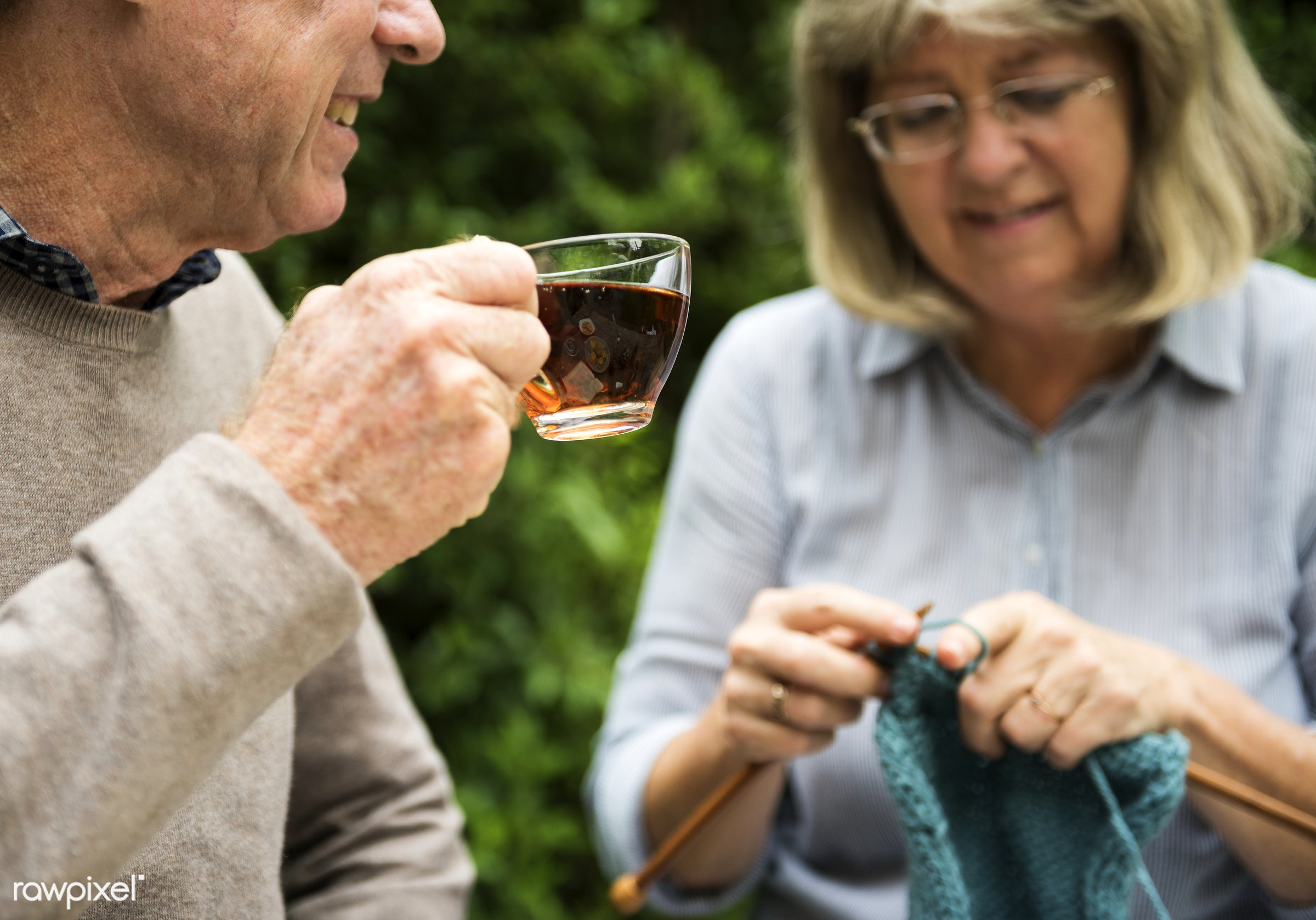 Old couple enjoying tea and knitting outdoors - couple, elderly, garden, home, knitting, leisure, marriage, old, outdoors,...