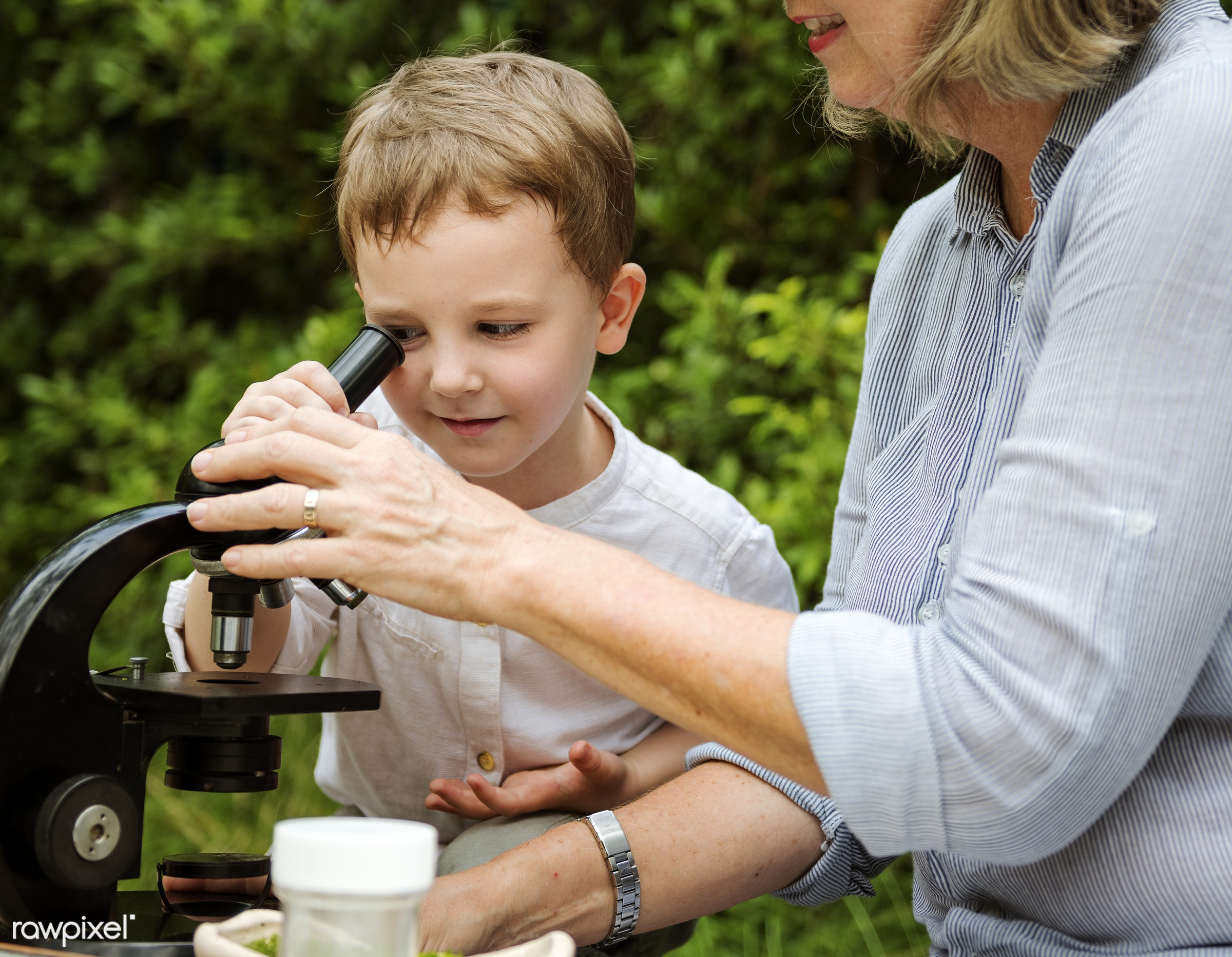 Young boy learning with old woman and telescope - grandson, young, boy, child, kid, cute, science, telescope, learning,...