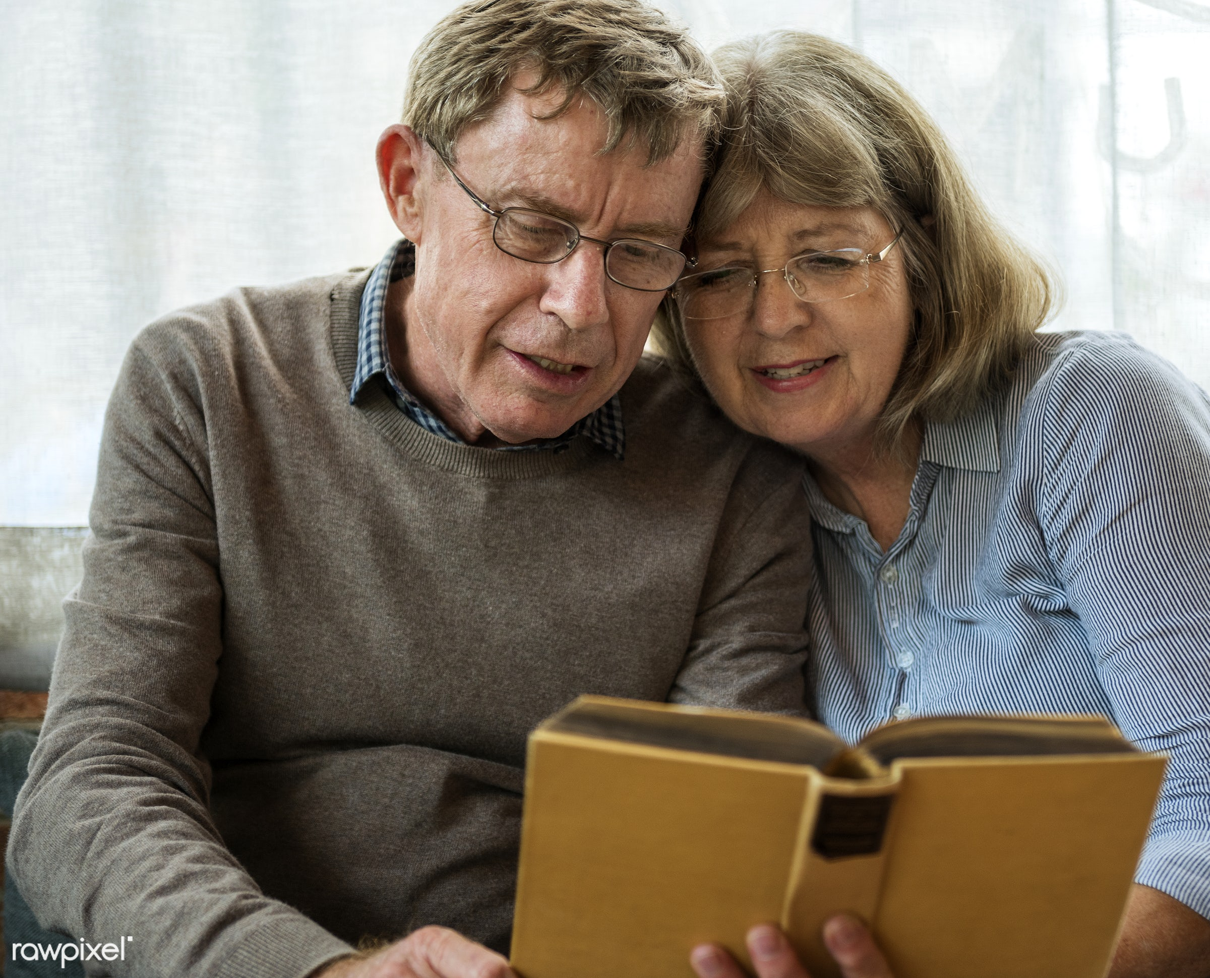 Old caucasian couple reading a book together - affection, book, couple, elderly, marriage, old, people, reading, senior,...