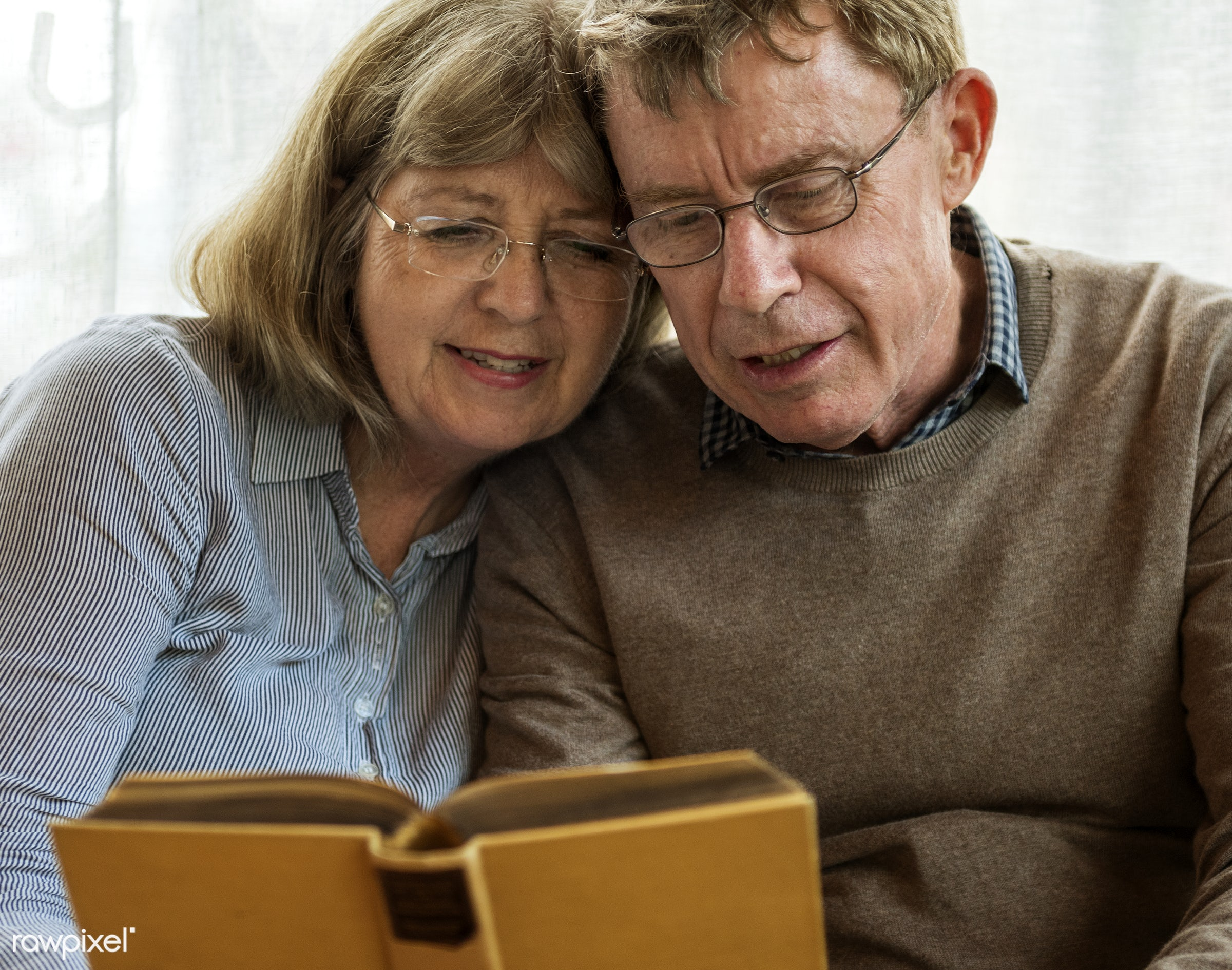 Old caucasian couple reading a book together - old, senior, elderly, caucasian, couple, together, marriage, reading, book,...