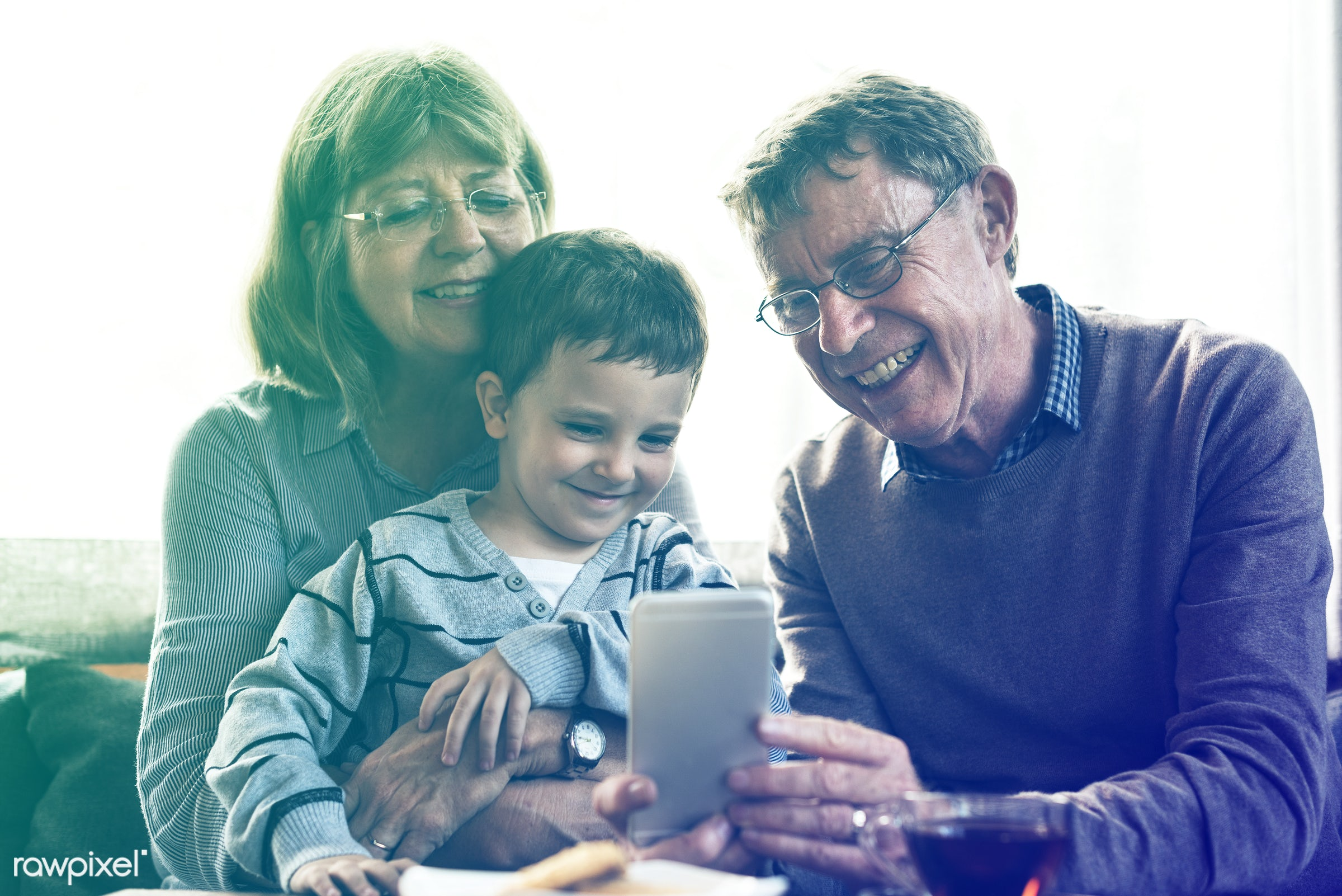 expression, person, phone, technology, grandfather, show, smitten, recreation, people, together, caucasian, kid, grandchild...