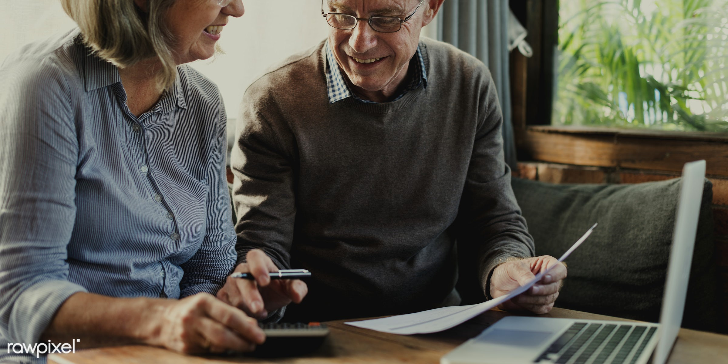 Old couple filling out a form - old, senior, elderly, caucasian, couple, together, marriage, fill, form, laptop, finance,...