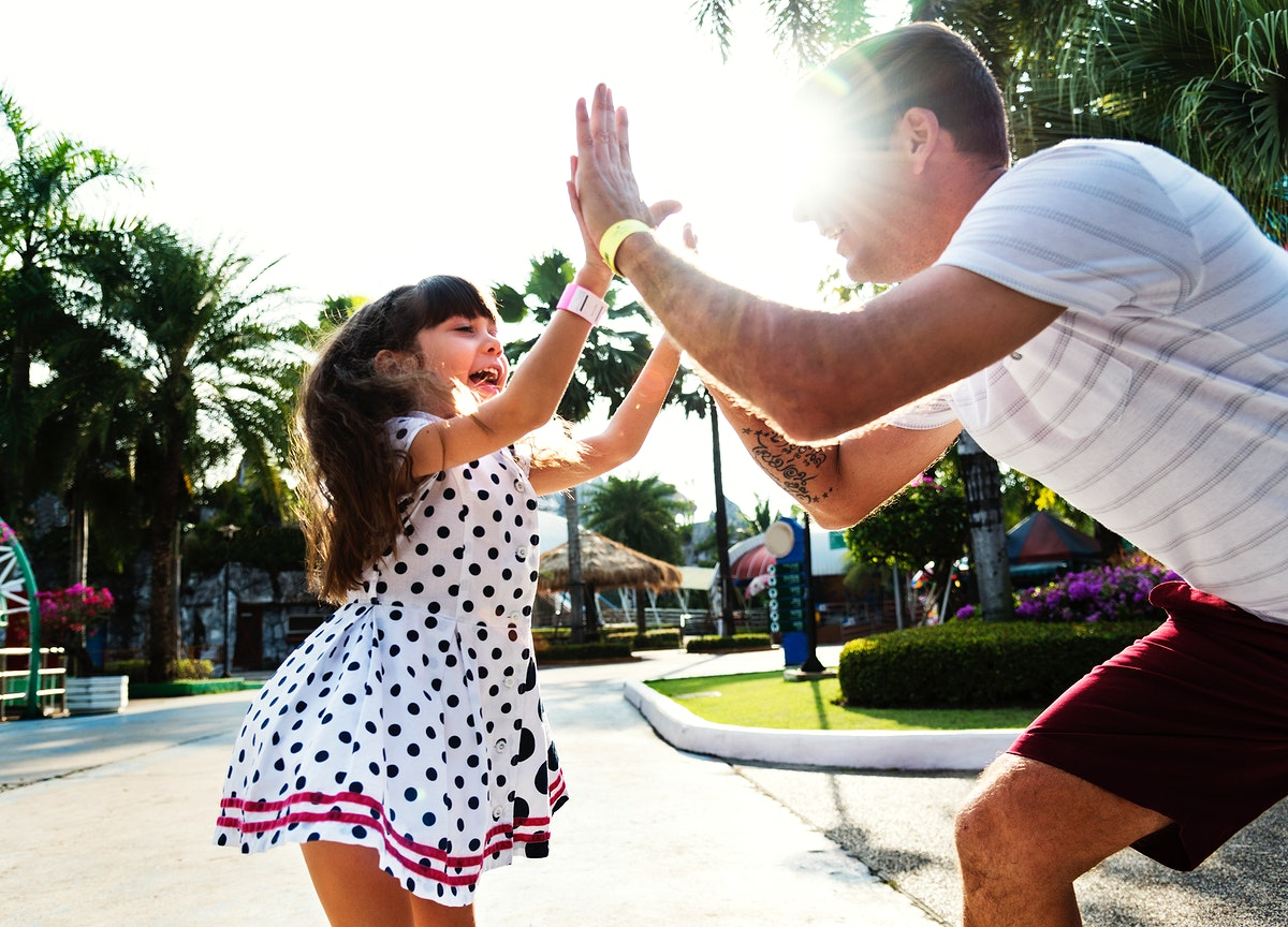 Daughter and dad doing a high five