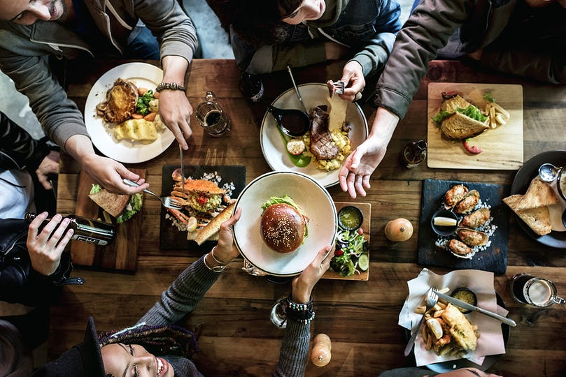 Group of friends eating together