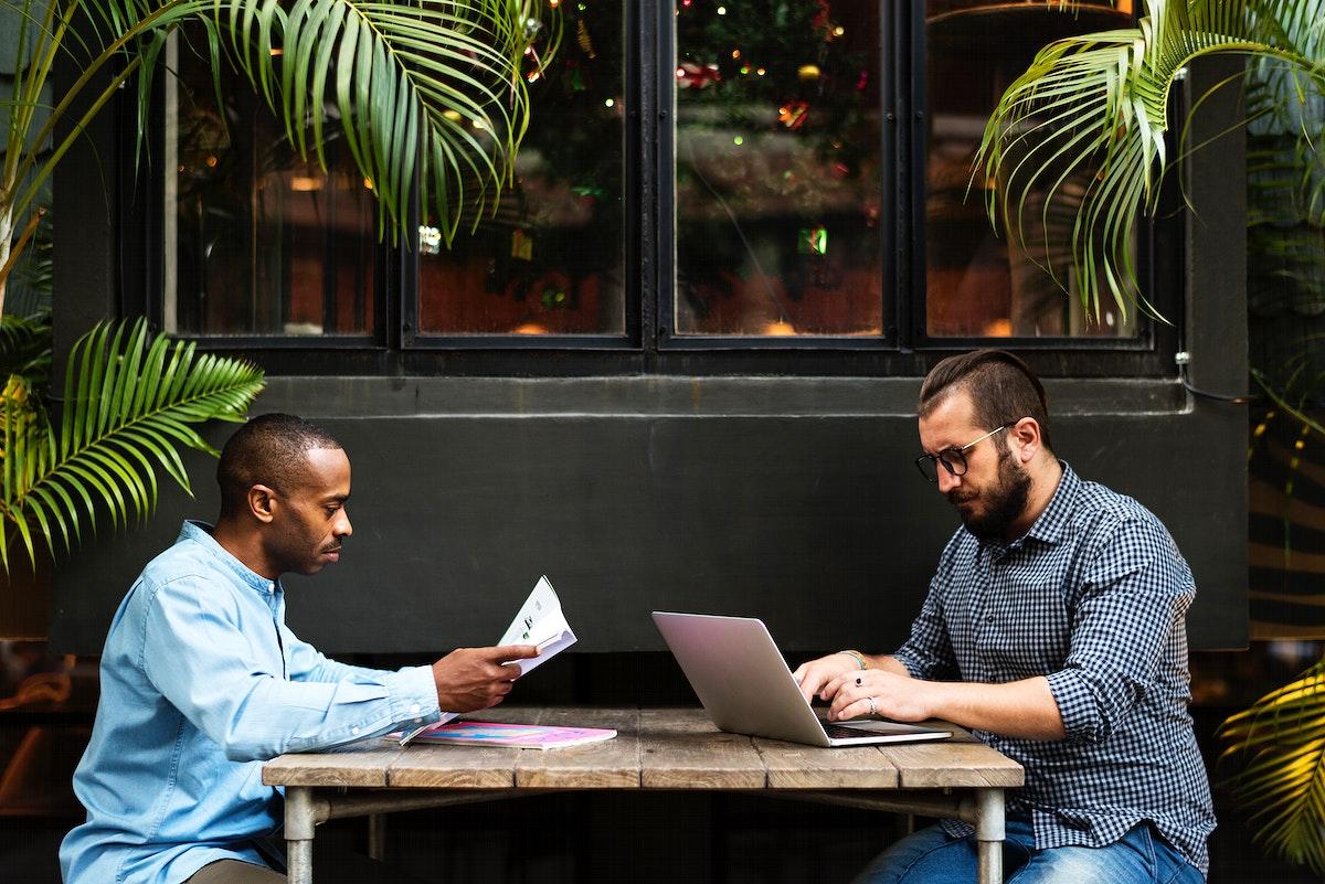 Men Sit Cafe Use Laptop Read Newspaper