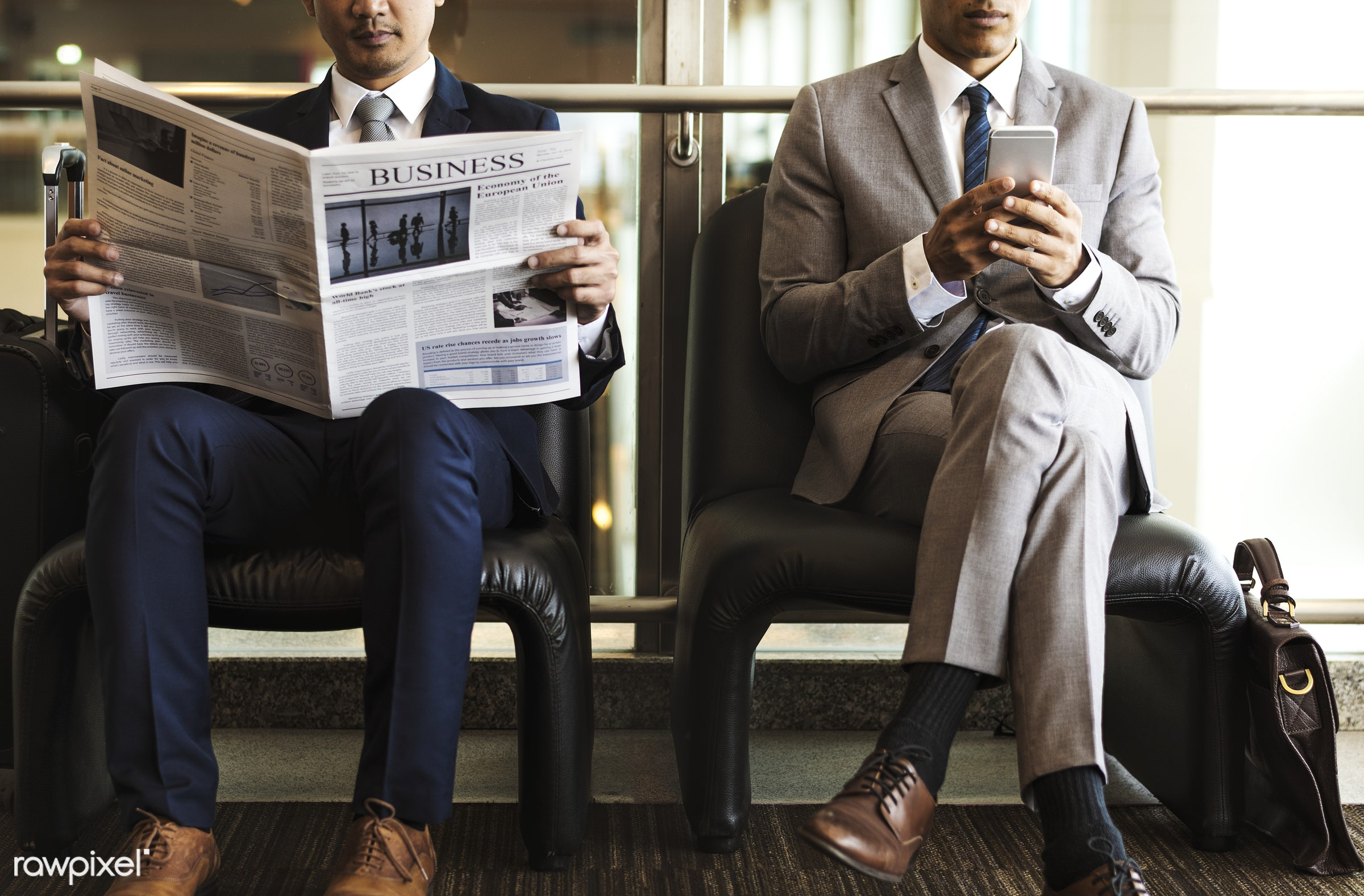 Businessmen reading the news - phone, adult, break, business, businessman, businessmen, candid, cellphone, chairs,...