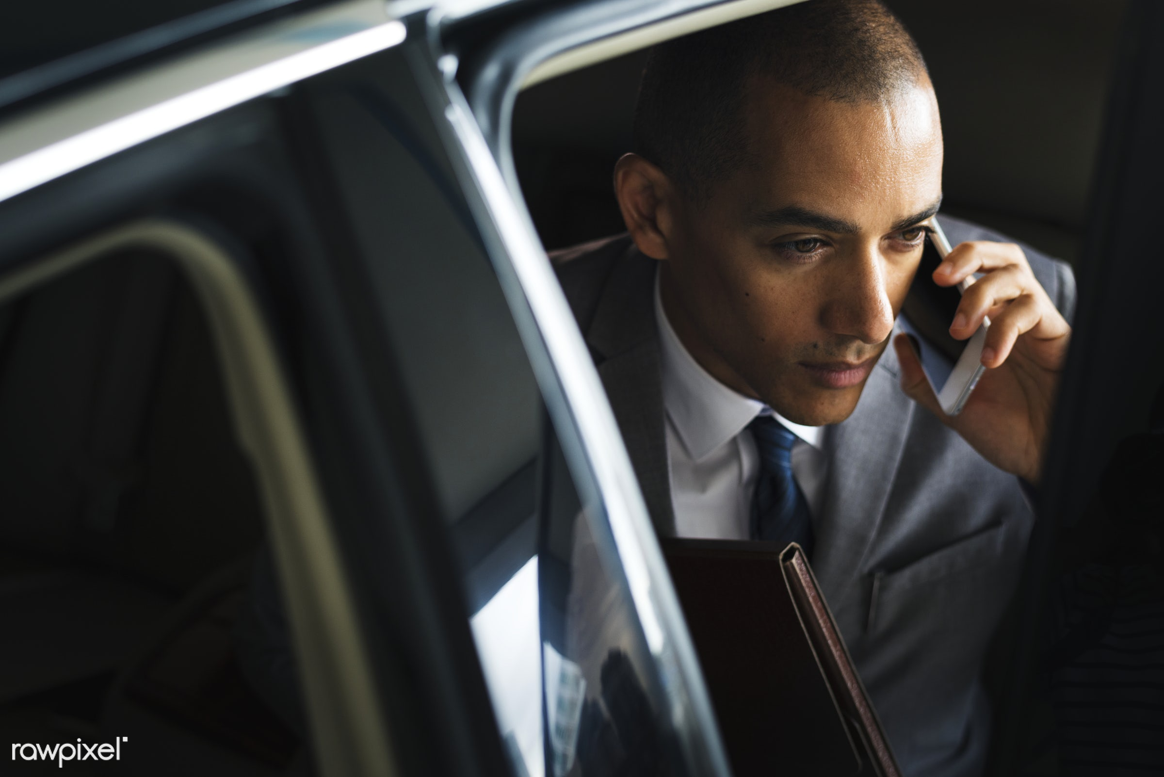 Businessman traveling alone by car - call, businessman, handsome, business, business men, candid, car, cellphone,...