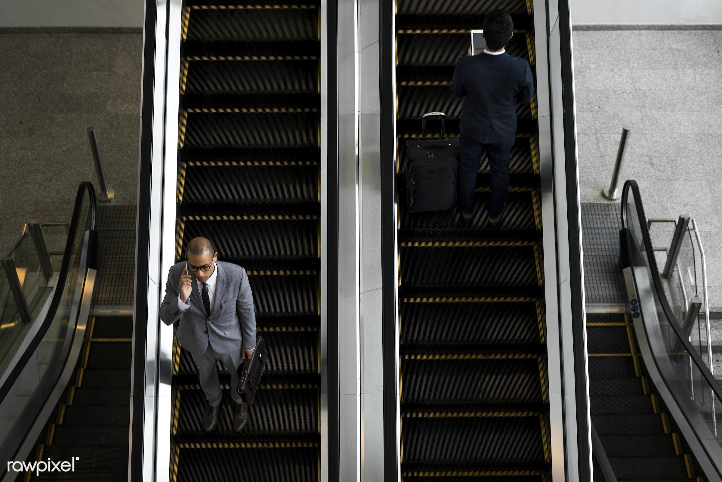 Businessmen on the escalator - technology, call, escalator, businessman, corporate, manager, asian, business, business men,...