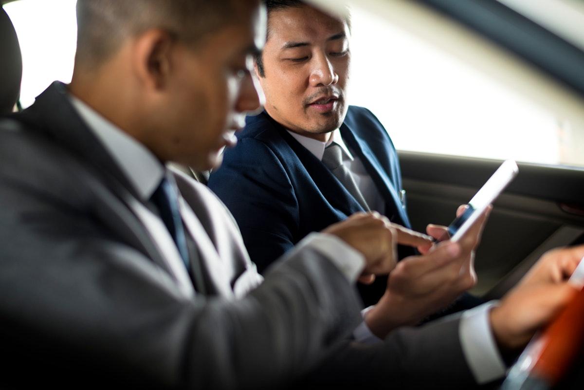 Businessman Use Mobile Inside Car