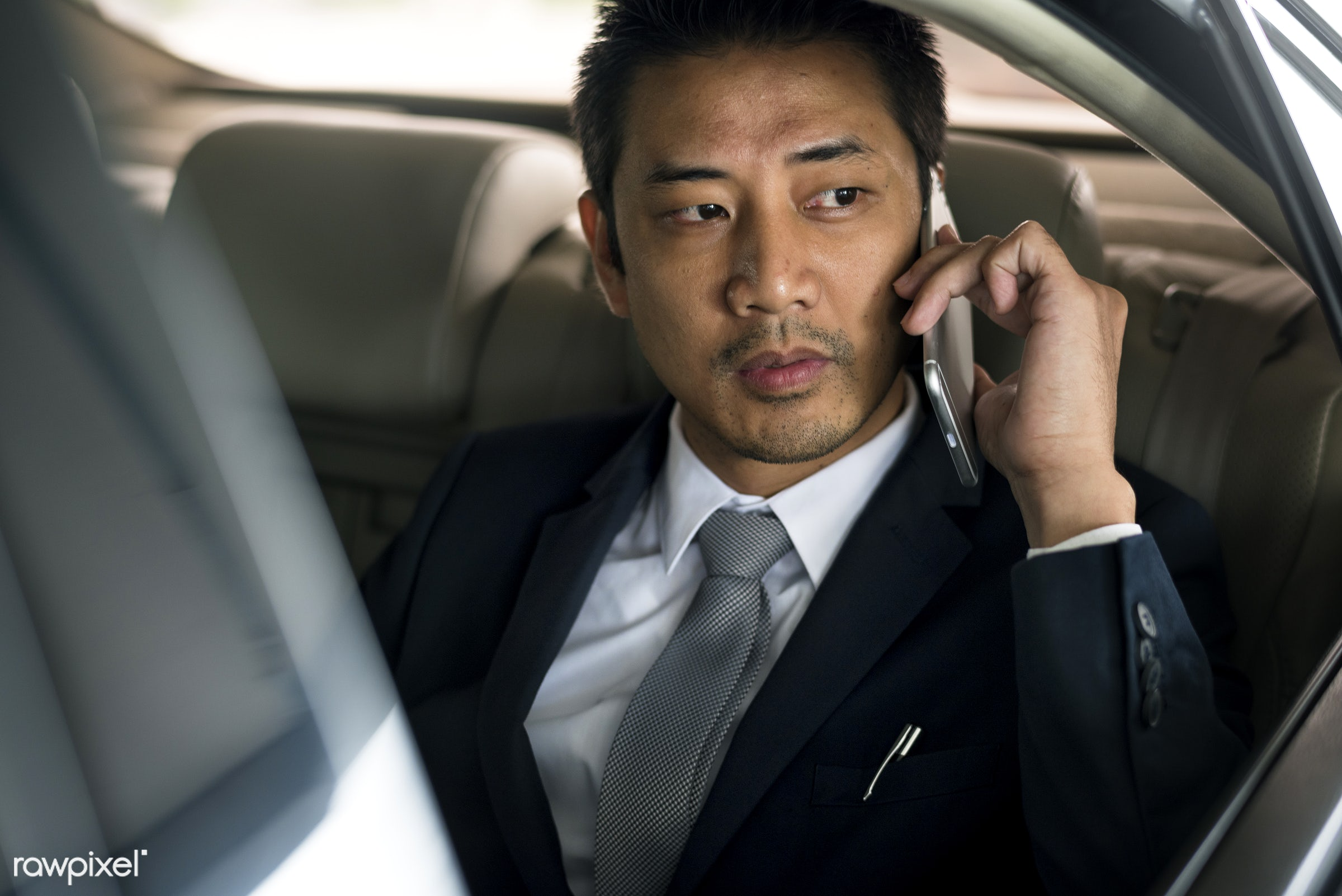 car, expression, call, face, phone, person, suit and tie, white collar worker, tie, vehicle, use, travel, transportation,...
