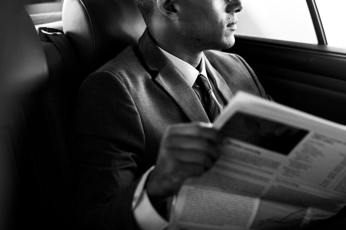 Businessman Sit Read Newspaper Inside Car