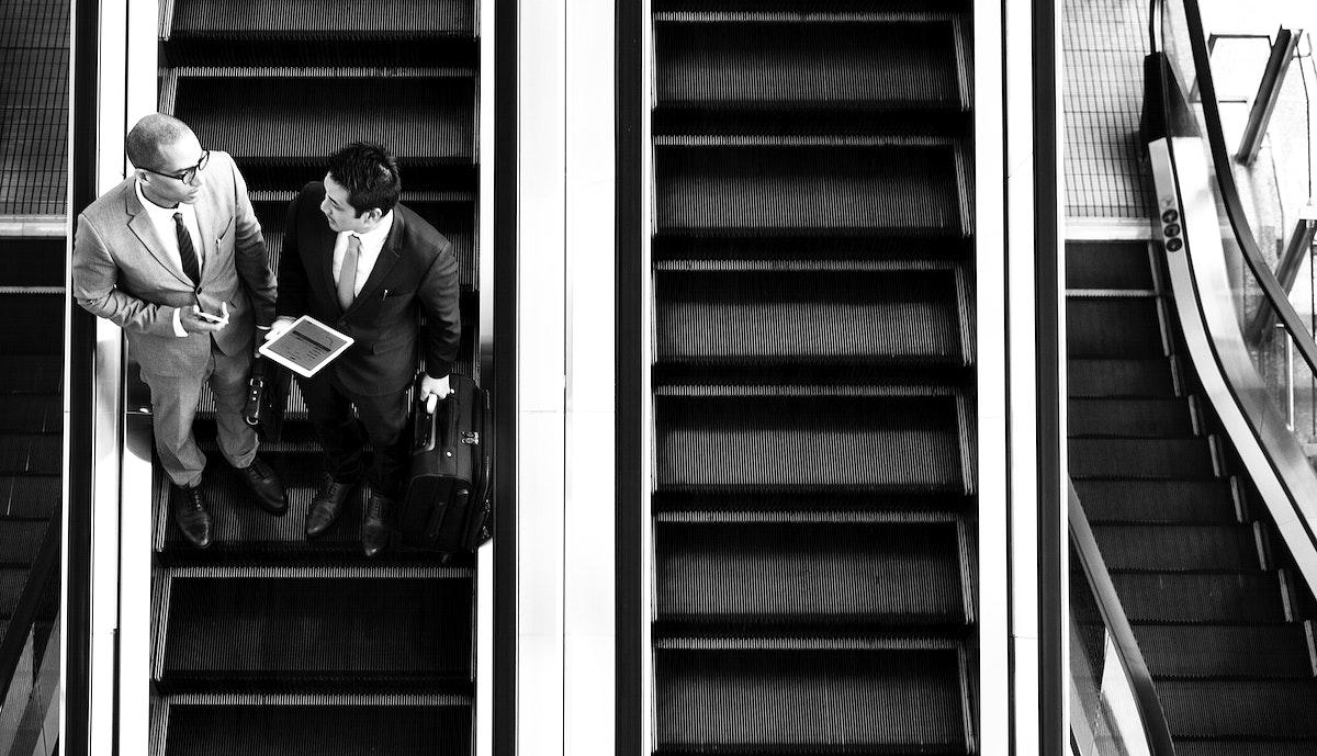 Businessmen on the escalator