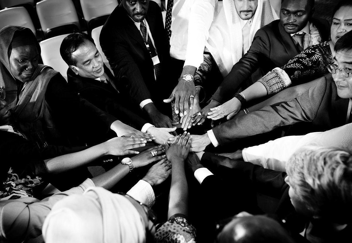A Group of Business People Putting THeir Hands Together