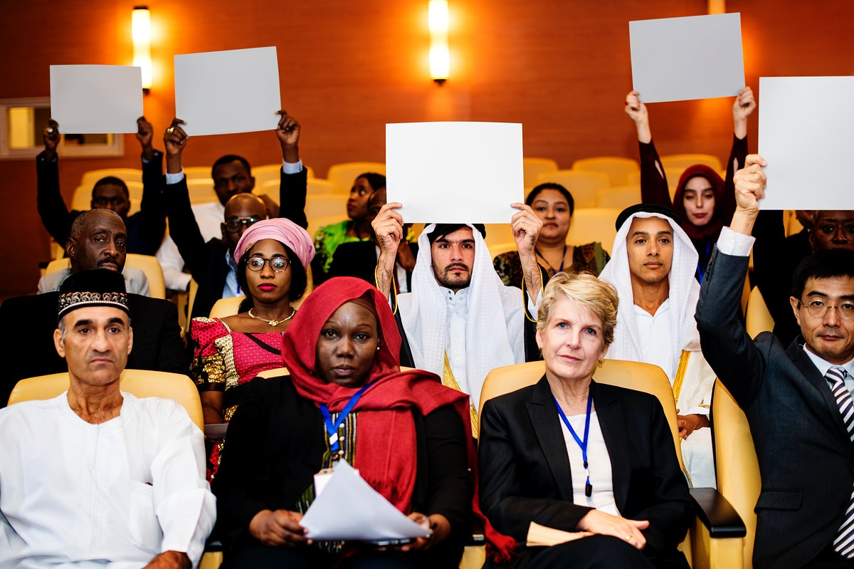 A Group of International Delegates are Voting