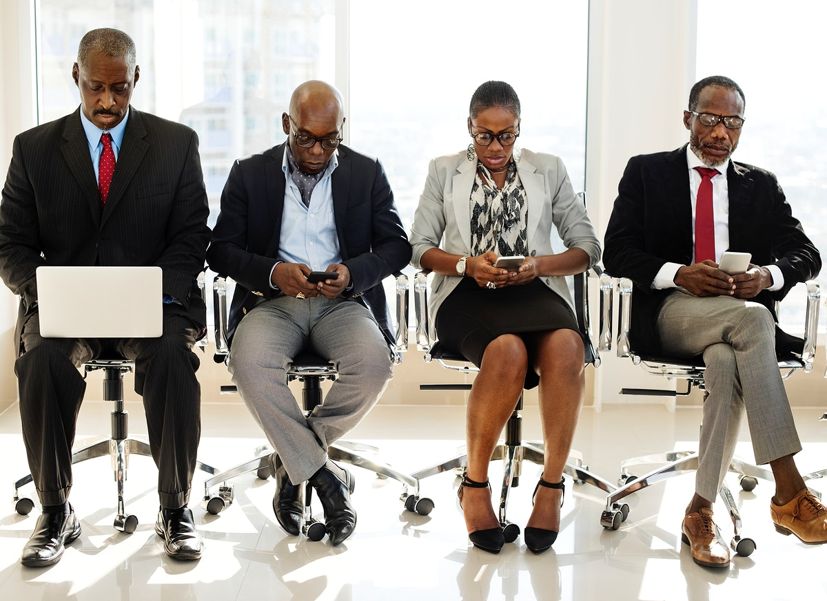 A Group of International Business People Are Sitting and Using Wireless Devices