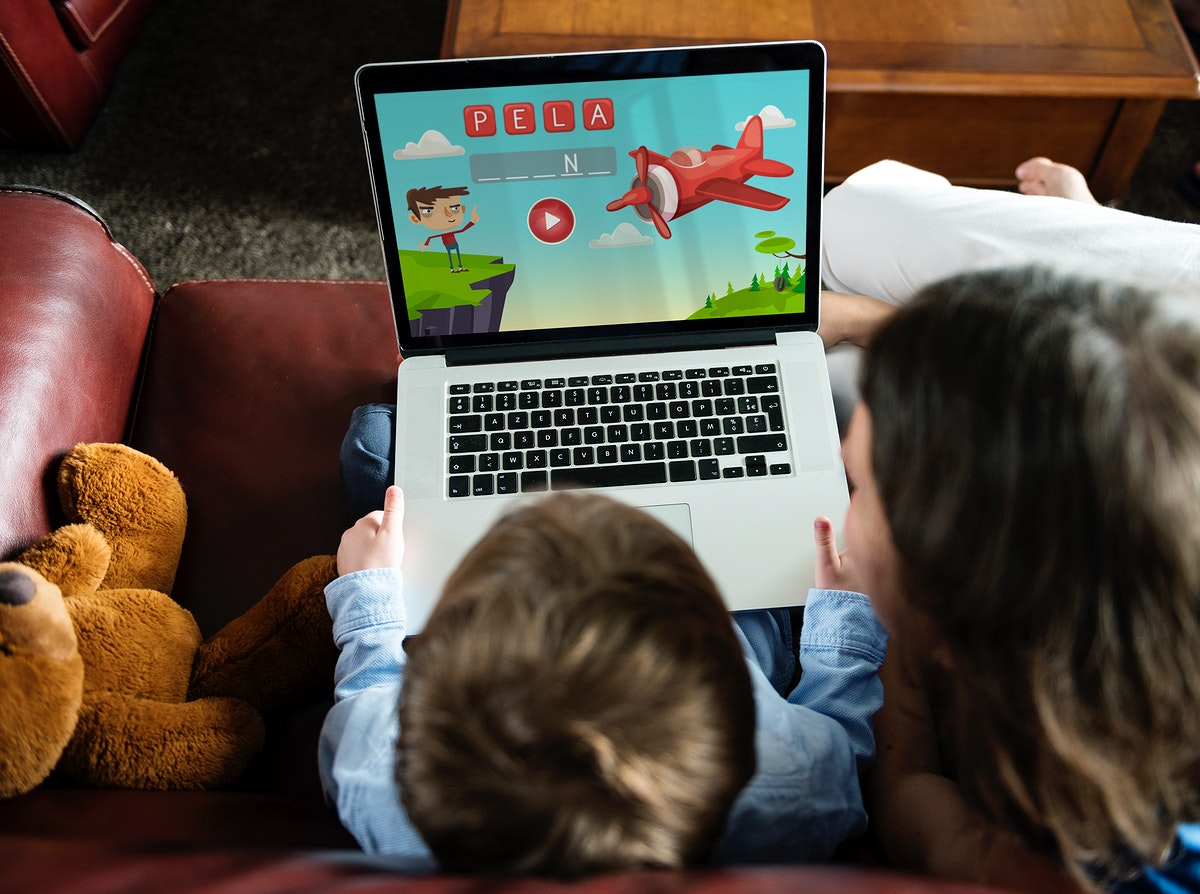 Son and Mom Using Laptop E-learning Game Education at Home