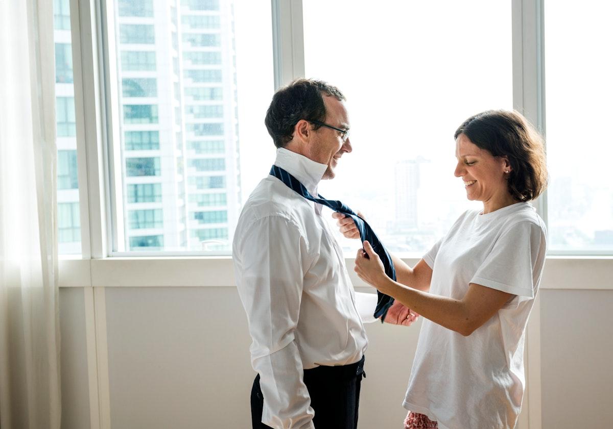 Wife helping to tie husbands tie