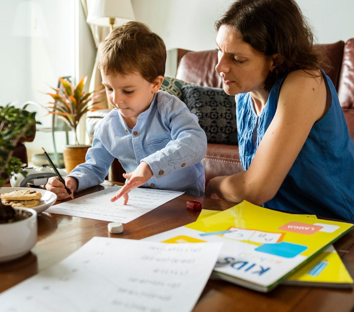 Mom Teaching Her Son Doing Homework