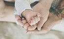 Closeup of family hands holding each other with love