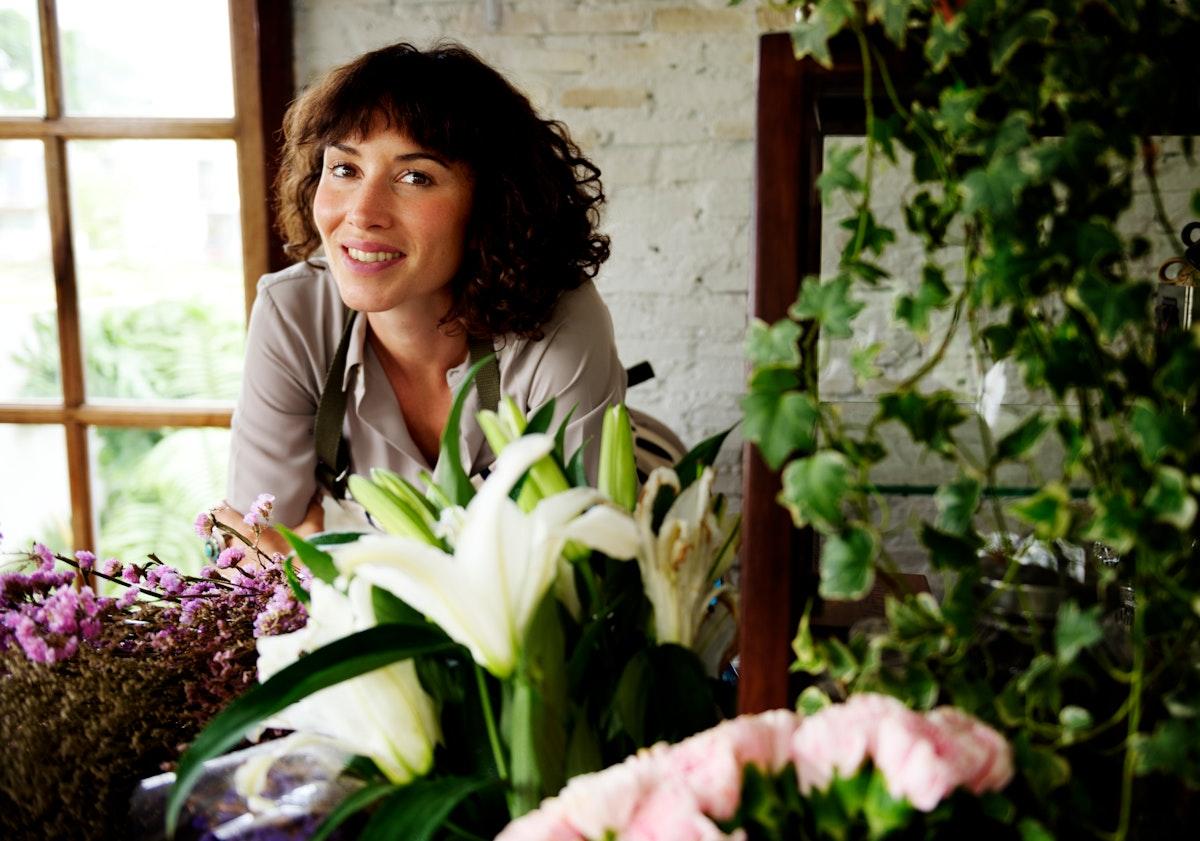 Caucasian florist woman inside flower shop
