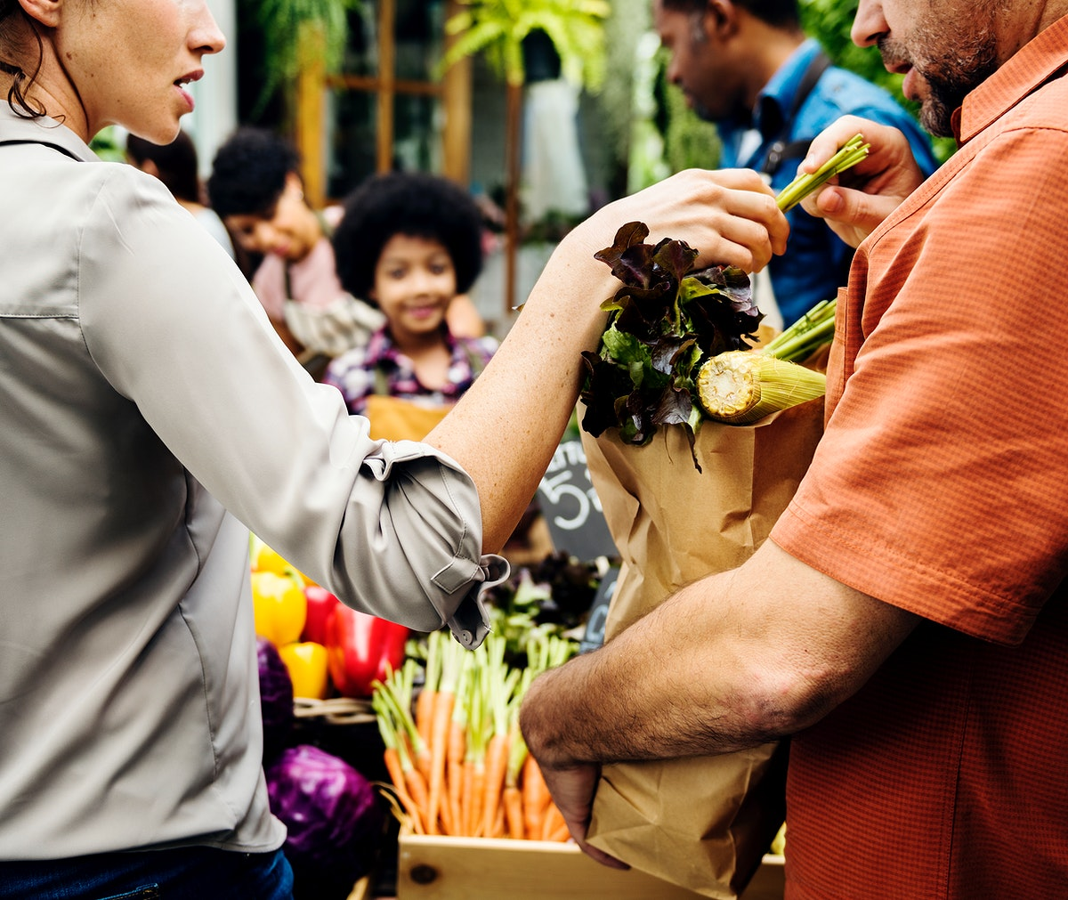 Couple buying fresh organic vegetables at the market