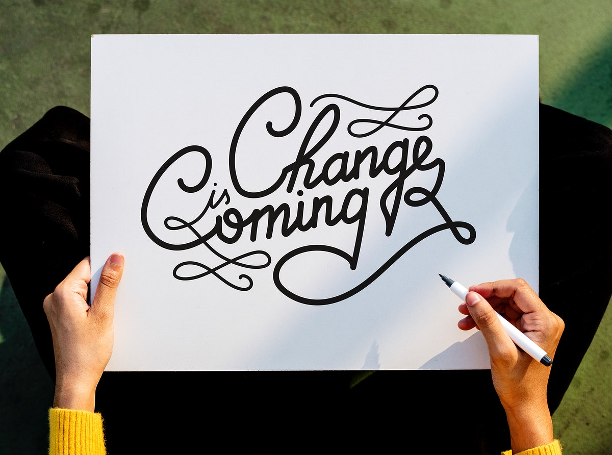 Hand writing Change is Coming text