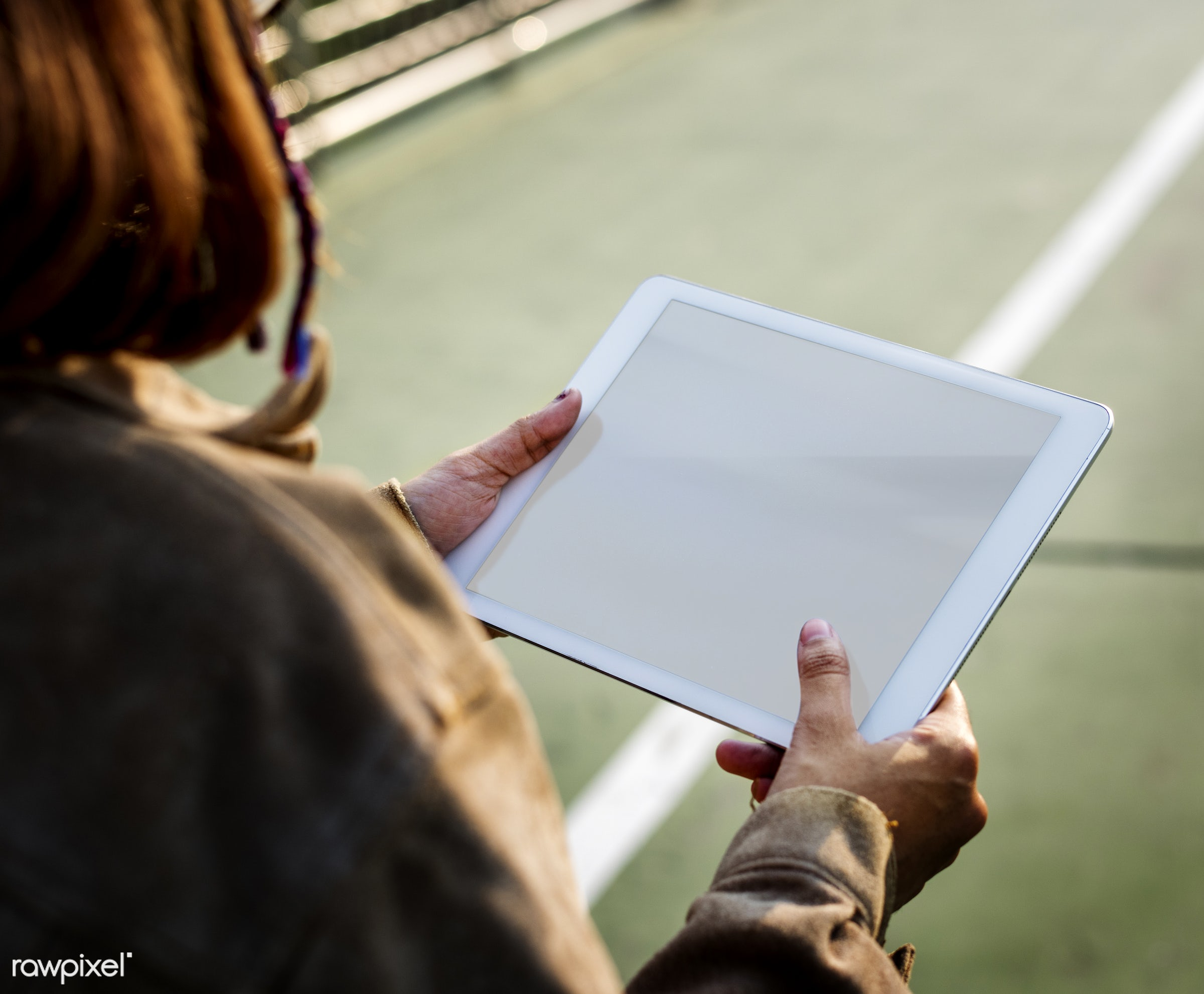 Woman holding tablet with blank screen - girl, tablet, digital, device, wireless, outdoors, blank, copy space, empty, design...