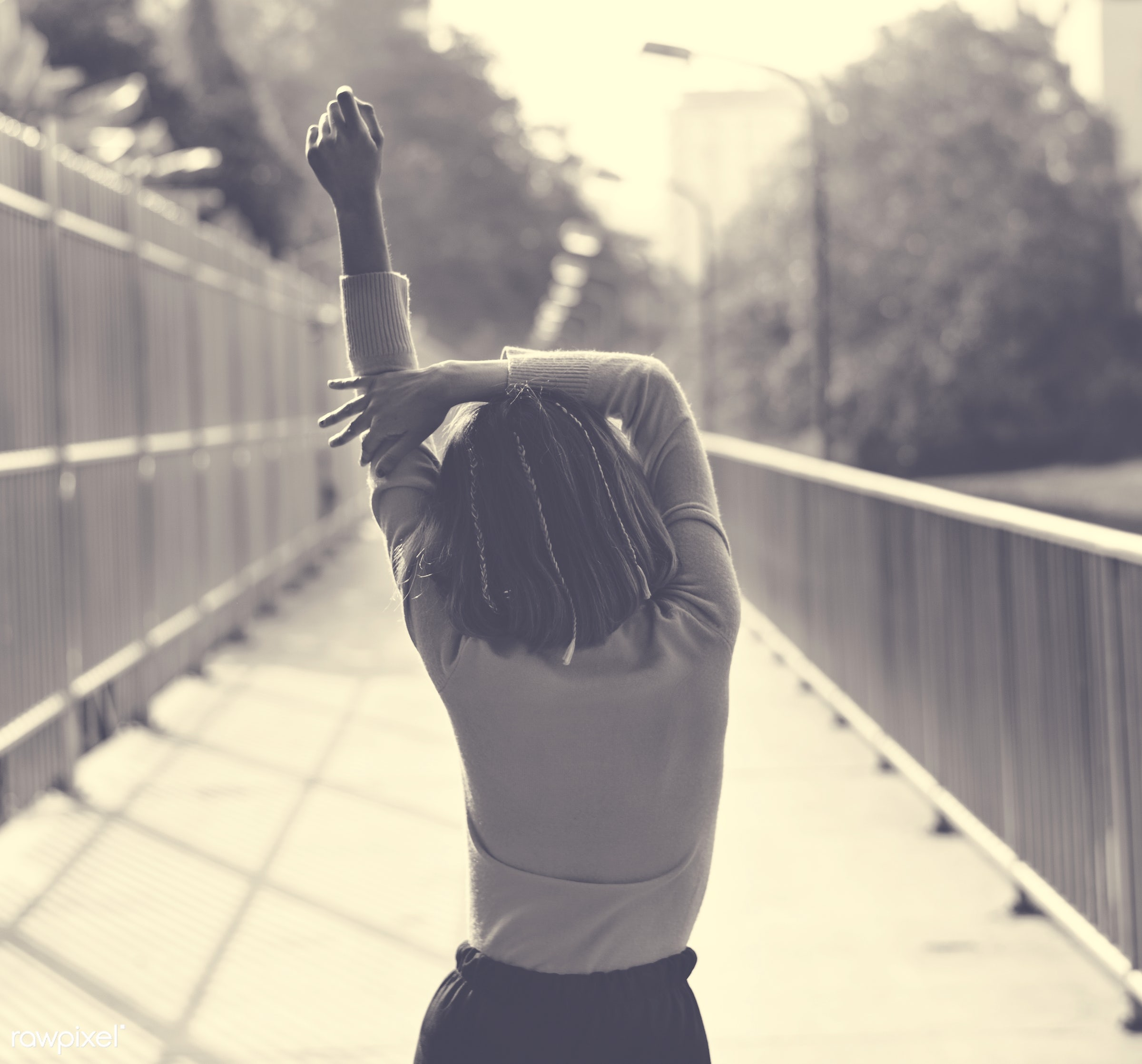 girl, woman, skinny, stretching, standing, street, city, alone, arm raised, pose, body, gesture, person