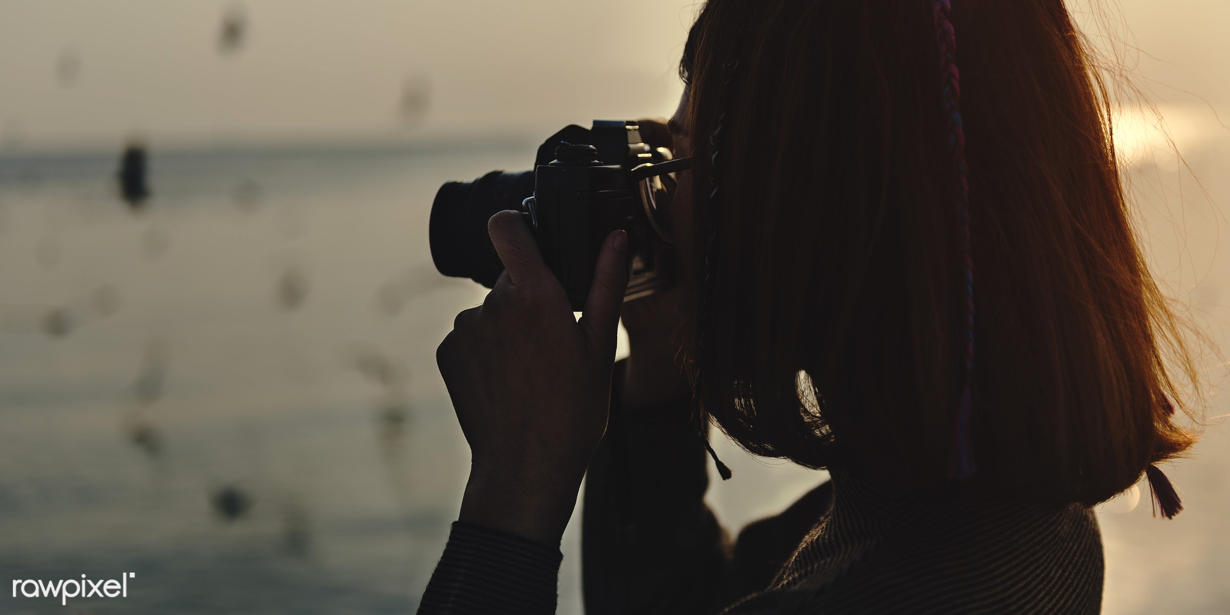 Girl using her camera outdoors - girl, woman, camera, taking, photo, picture, nature, outdoors, water, ocean, sea,...