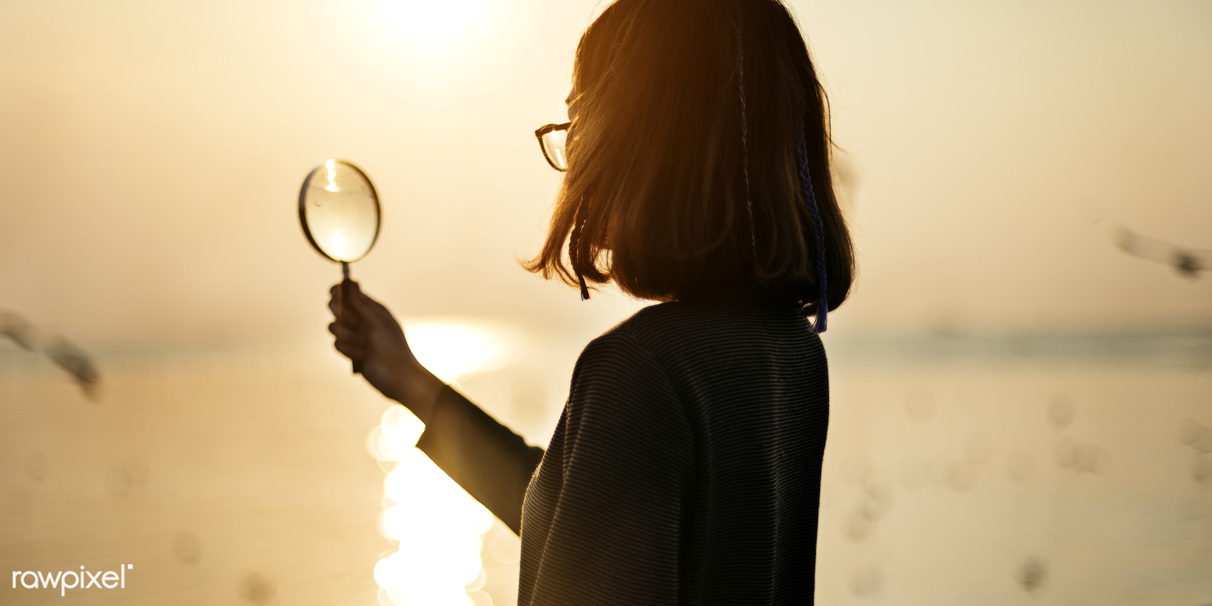 Silhouette of woman holding magnifying glass - girl, woman, holding, magnifying, glass, silhouette, sunset, nature, sky,...