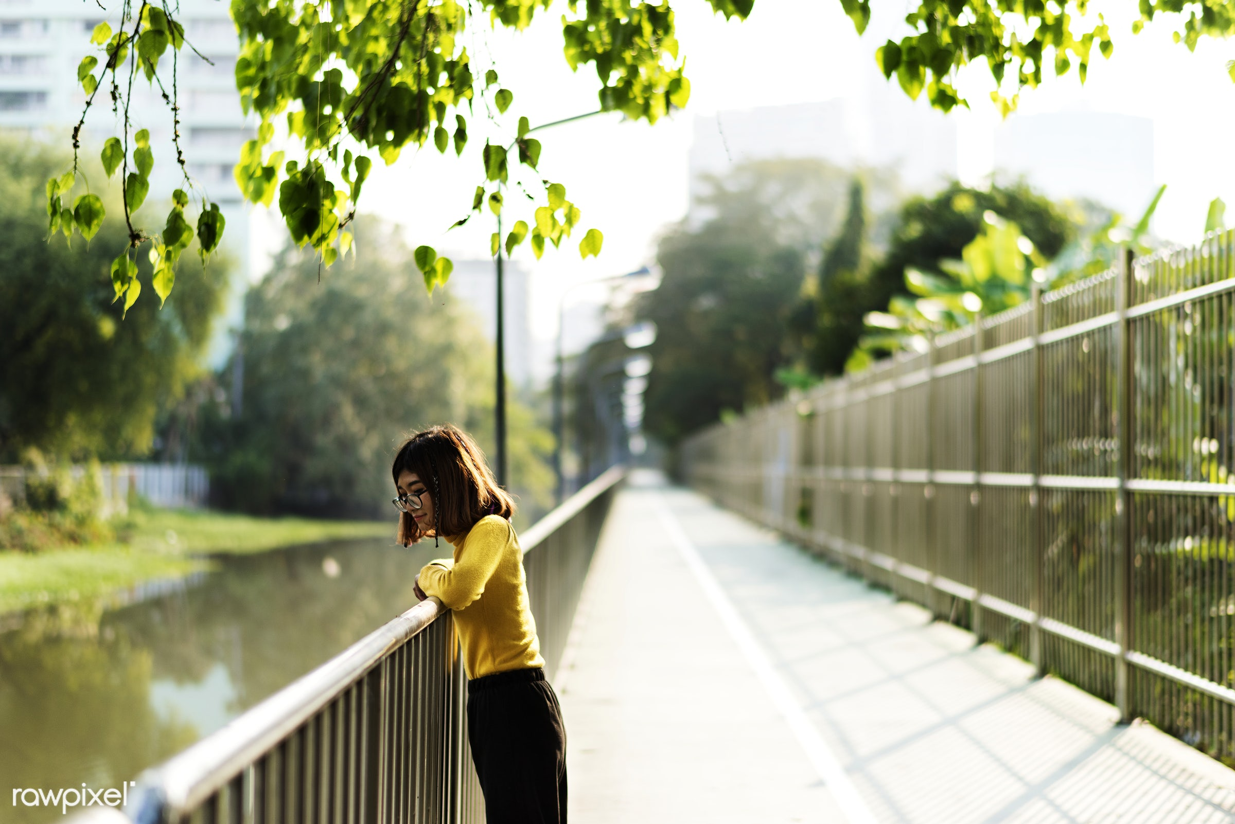 Girl looking at the river over the railing - girl, woman, looking, nature, outdoors, fence, railing, pathway, park, alone,...