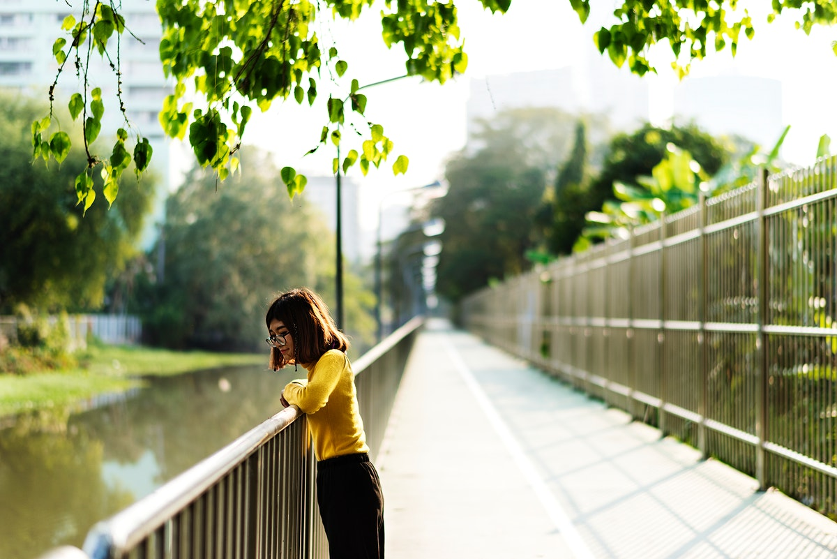 Girl looking at the river over the railing