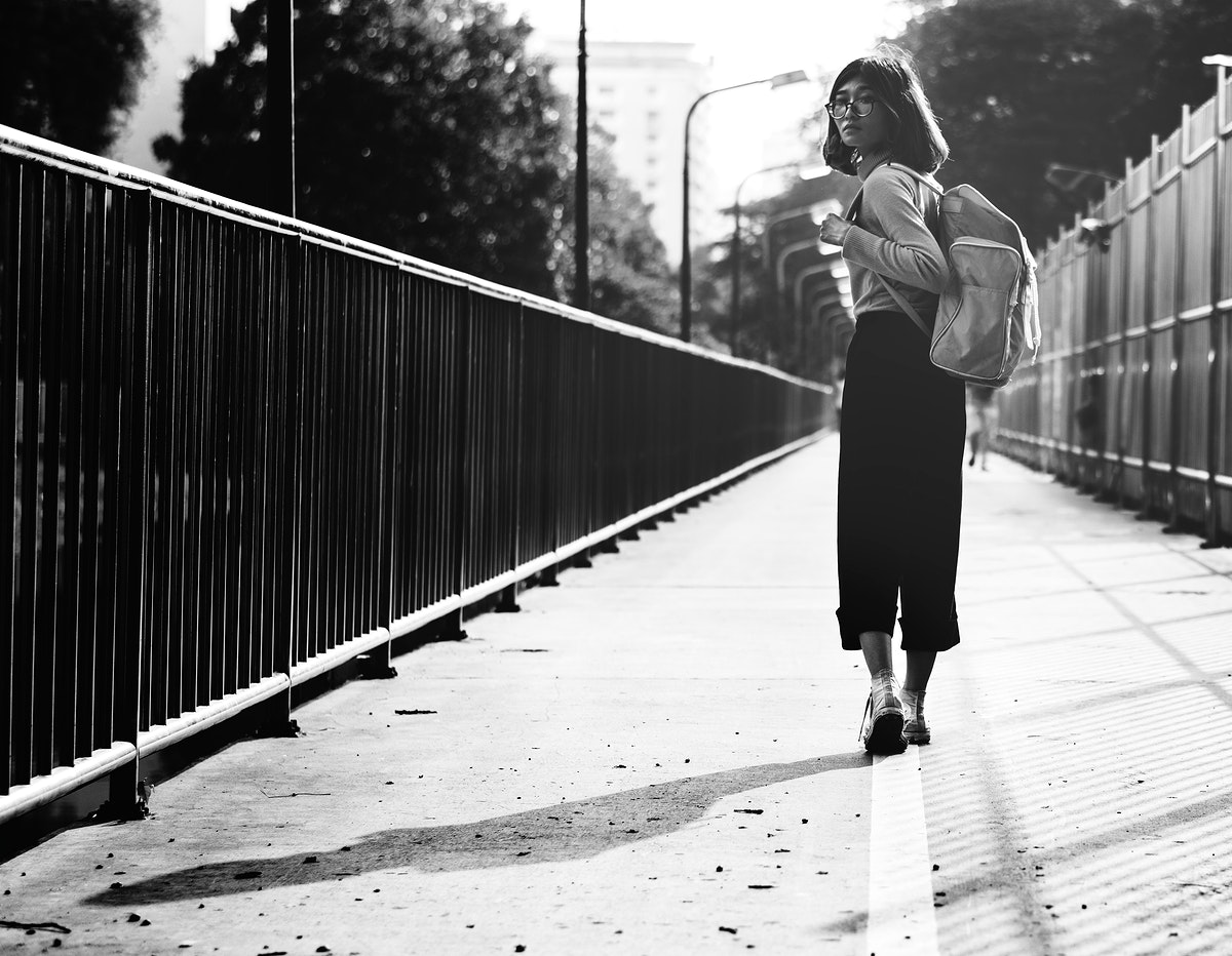 Girl looking back while walking