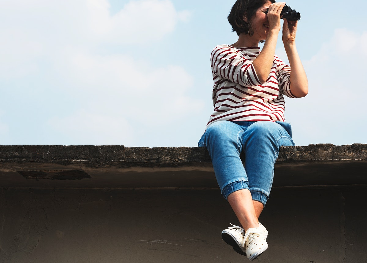 An Adult Woman Using Binocular and Looking at the Sky