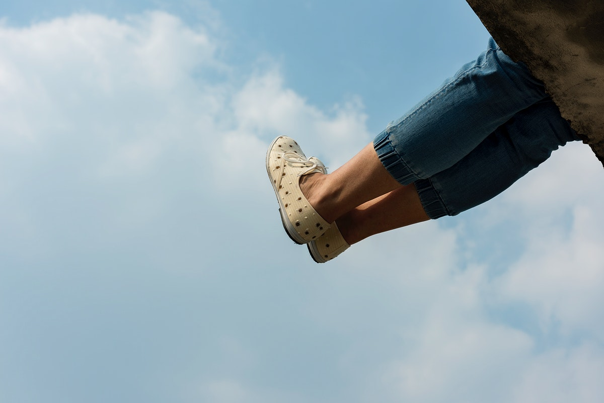 A Person with  Legs Up In The Sky