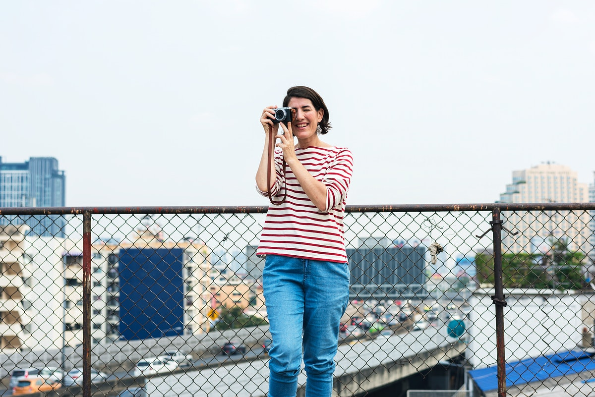 An Adult Woman With Camera Capture Snap Shot Outdoor Activity