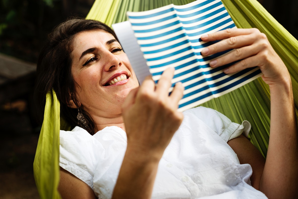 An Adult Woman Reading Book on a Hammock
