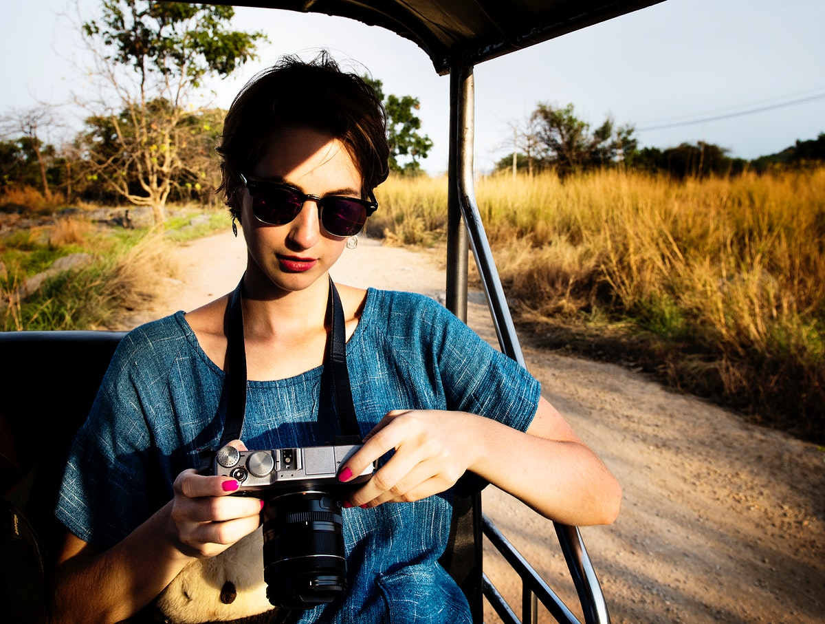Woman Looking at Camera and Cheking Photos