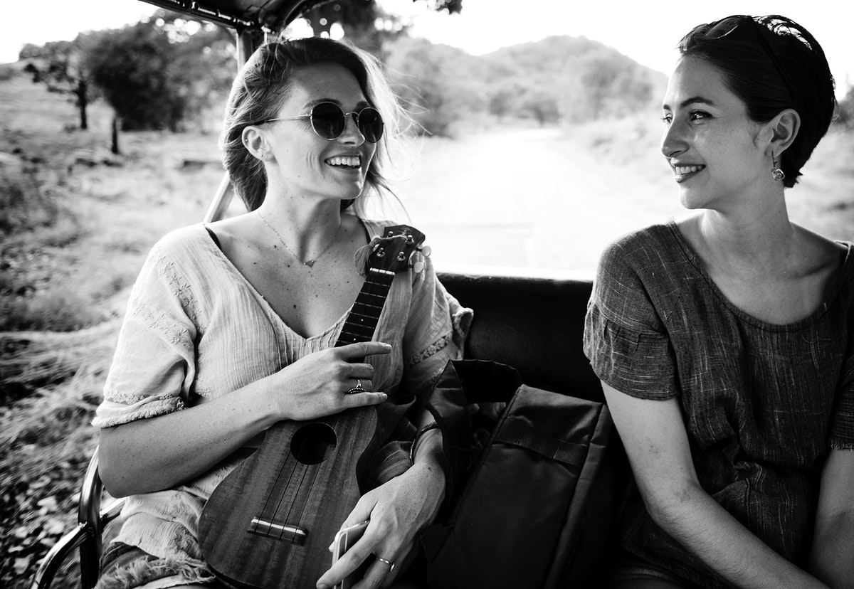 Girlfriends on the road trip to the nature