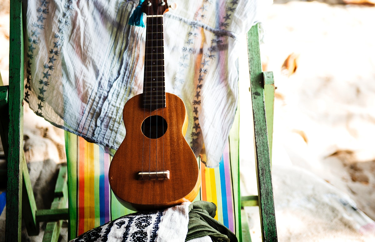 Ukulele on deck chair on the beach vacation