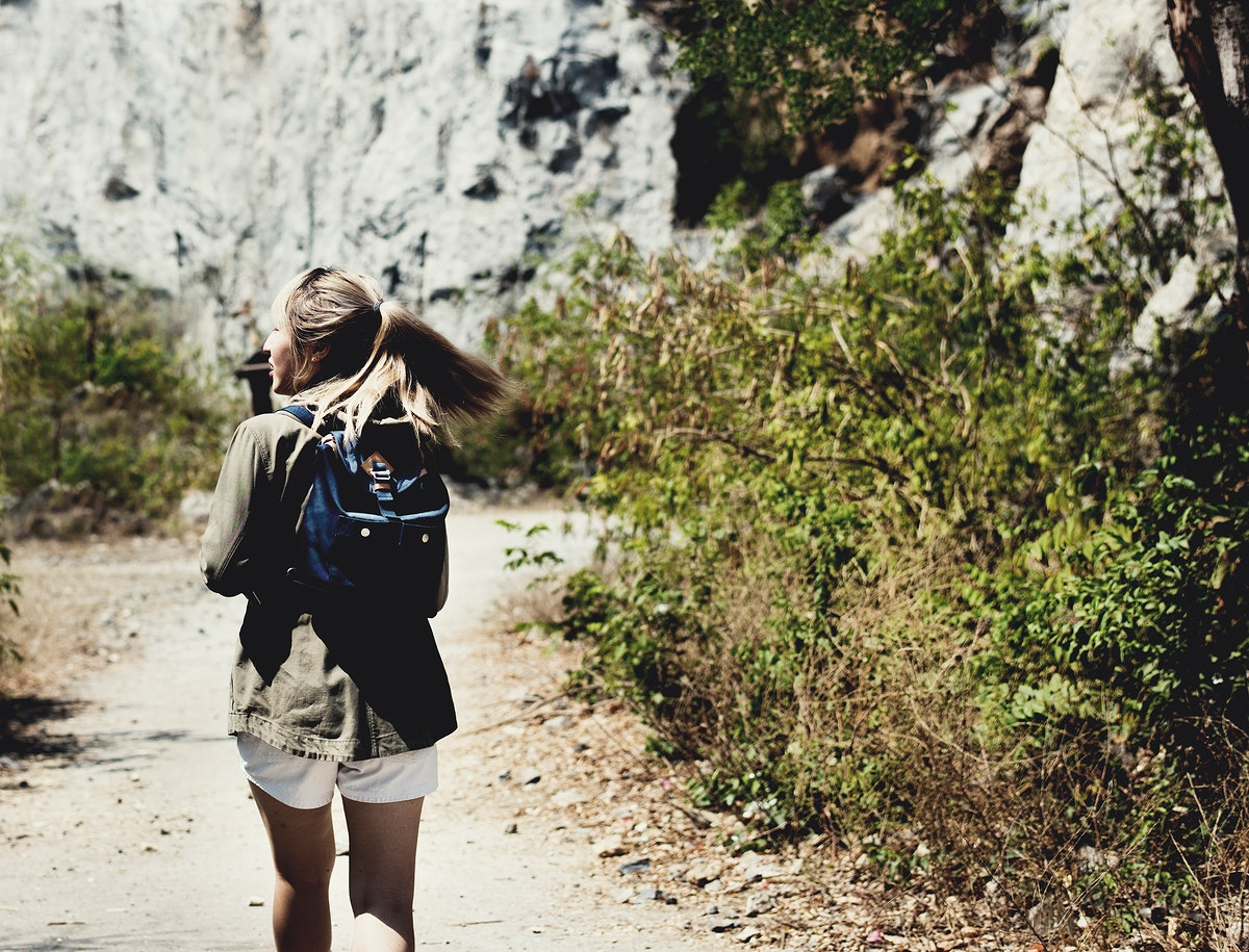 Young woman traveling outdoors alone