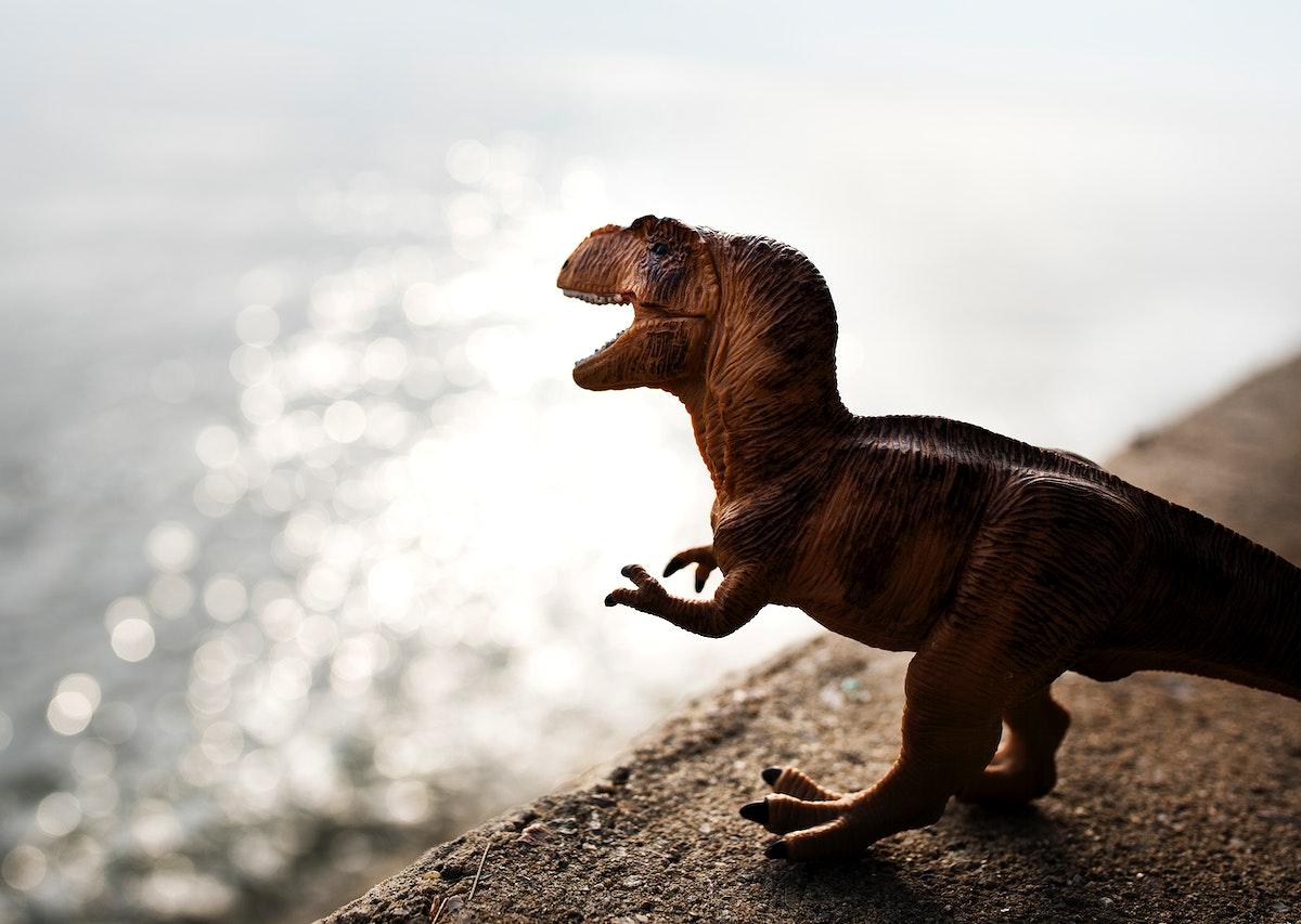 Tyrannosaurus rex jurassic figure toy in the river