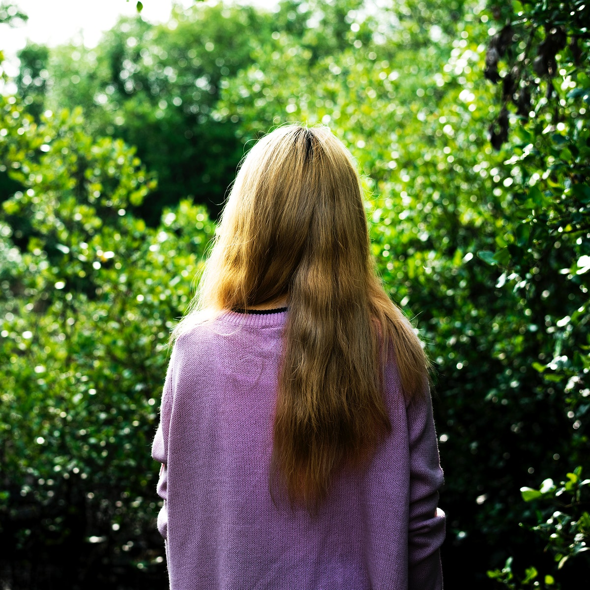 Rear view of woman with long hair in the garden