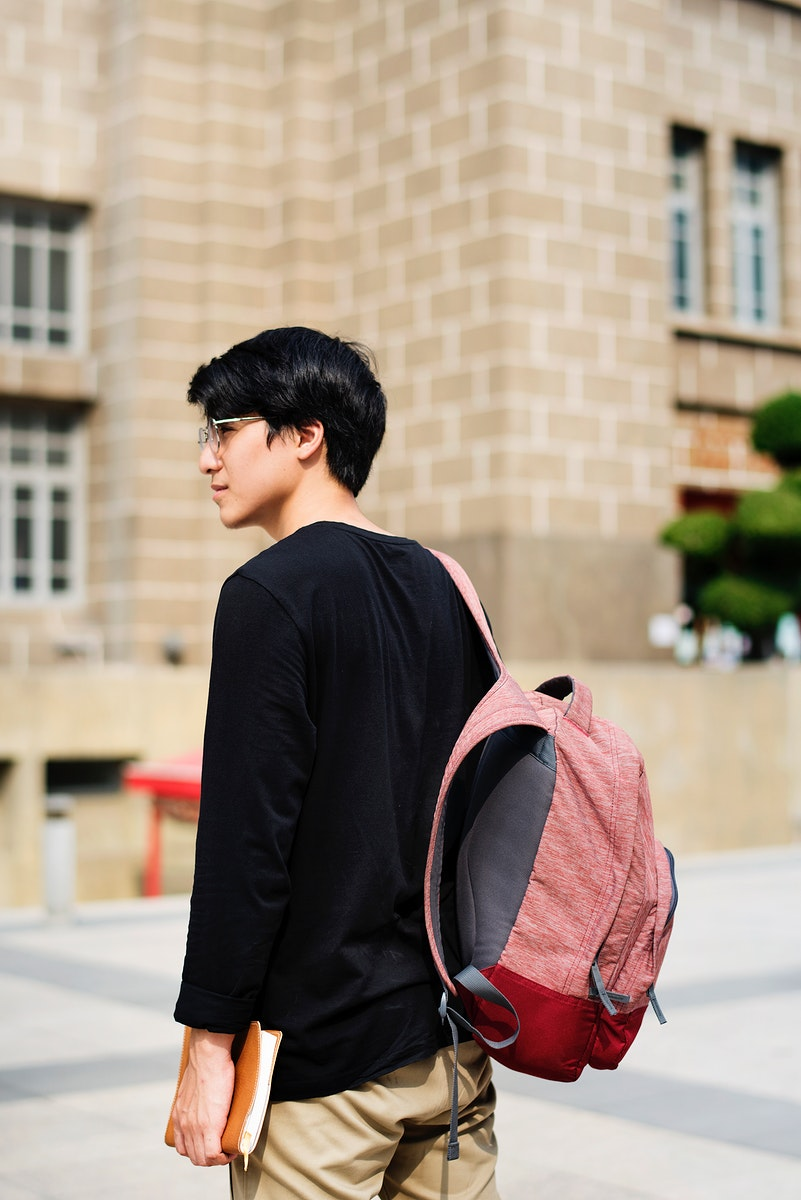 Young asian guy with a backpack