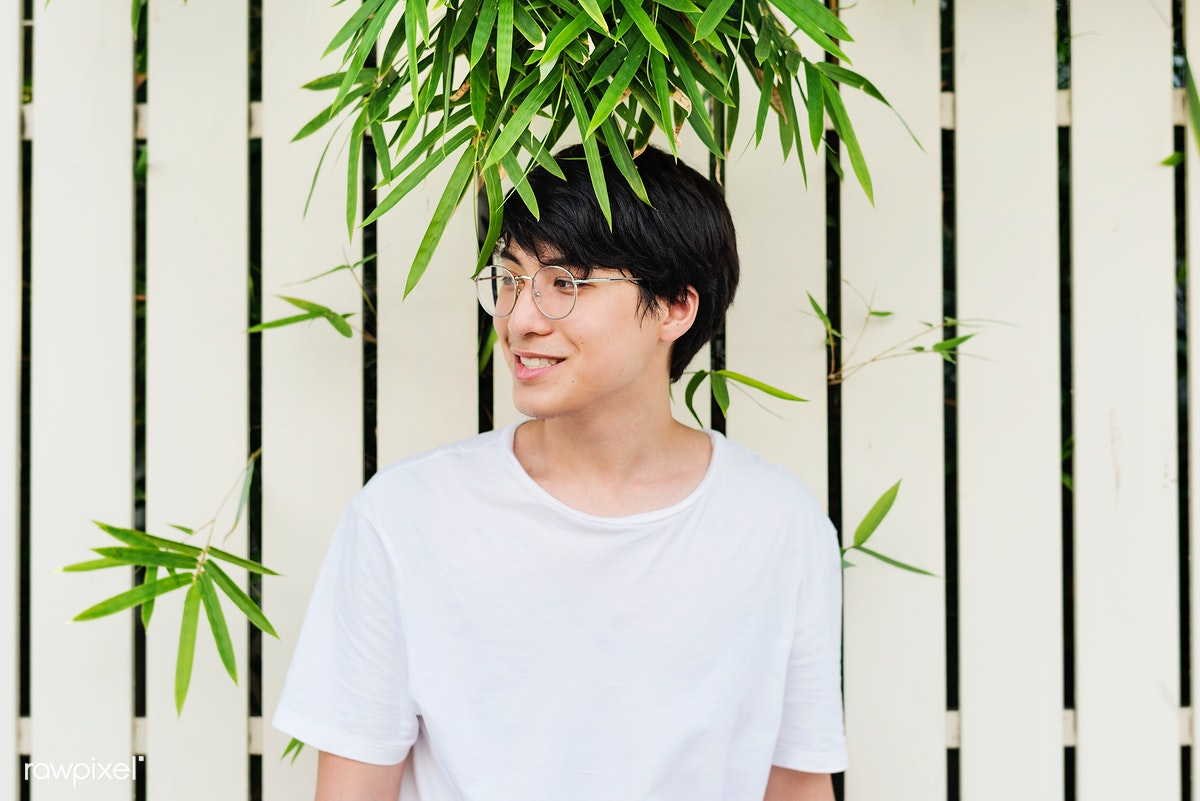 c9605906dd2 Young asian guy wearing glasses portrait