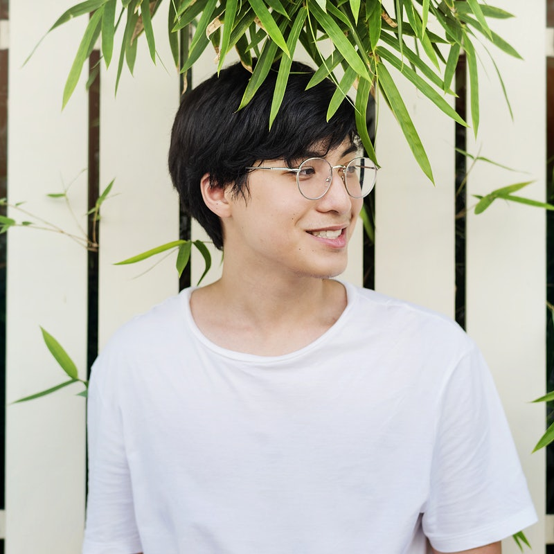Young asian guy wearing glasses portrait