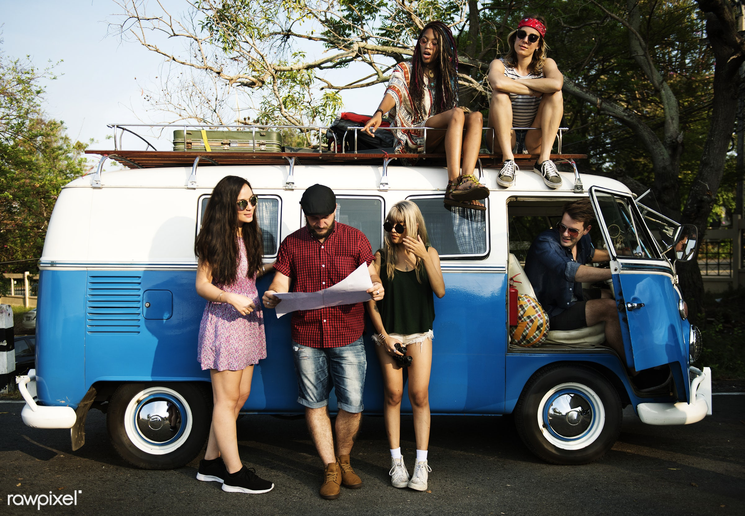 Diverse group of people enjoying a road trip and festival - van, street, roof, adult, adventure, check, direction,...