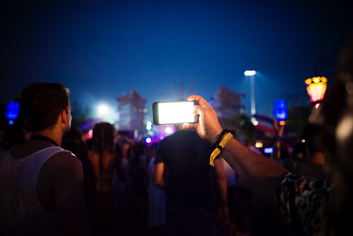 People Taking Photo in Music Concert Festival