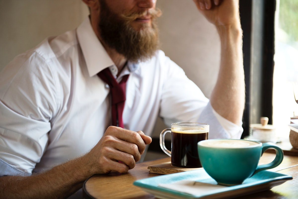 Man chilling out with coffee at cafe