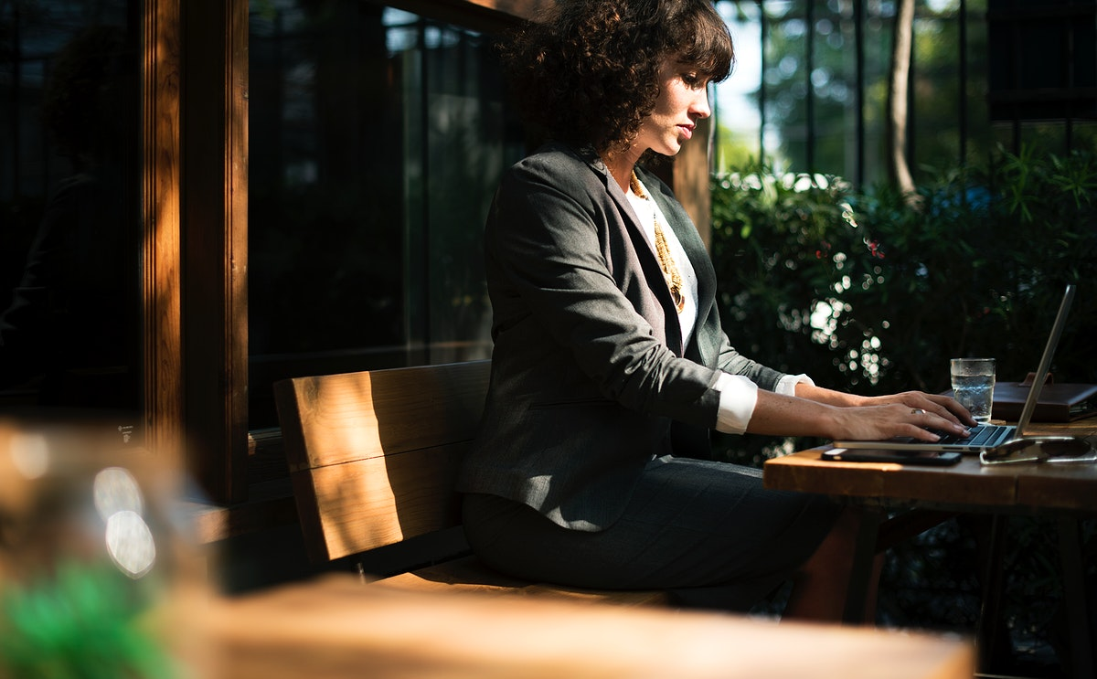 Woman working with laptop at coffee shop